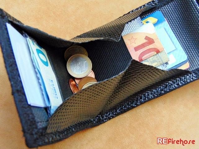 Hard wearing wallet from very strong and durable fire hose not from leather
